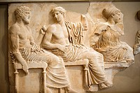 Carved slap of Poseidon, Apollo, and Aartemis at the Acropolis museum. Athens, Greece.