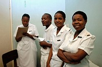 Four nurses pose in an office at the Howard Hospital outpatient department. Some of the nurses attend the training centre. The hospital is located in ...