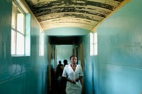 A nurse walks the hallway from the Howard Hospital Emergency to the Male Ward. The eighty year old salvation Army operated facility sometimes shows it...