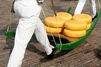Running carriers with cheese on pallet, cheese market, Kaasmarkt, Alkmaar, Holland, Netherlands