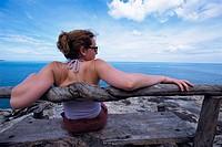 Woman looking at sea. Ko Samui. Thailand.