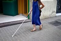 Blind woman using walking stick