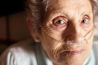 Elderly woman using a nasal oxygen cannula