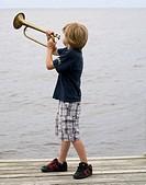 boy blowing bugle Albemarle Sound, NC