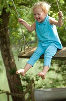 young girl swinging and laughing Greenbrier River, WV