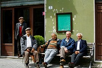 Local men sitting on a bench, Sperlinga, Sicily, Italy