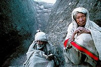 Old people pray outside of the rock carved chruches of Lalibela.