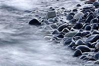 Sea floating over pebbles. Hålsangviken, Grönsviksfjärden, Noraström, Västernorrlands län, Sweden, Scandinavia, Europe