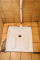 French squat toilet, used by squatting, rather than sitting.