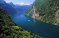 A cruising ship, in the Geiranger fjord and on right the ´seven sister waterfall´ on the left in the foreground the farms of Skagfela, More de Fjordan...