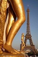 Gilded bronze statue decorating the central square of the Palais de Chaillot with Eiffel Tower in the background. Paris. France