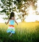 Girl, age 5, summer flower picking,