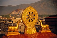 Roof of Jokhang temple with Potala palace in background, Lhasa. Tibet, China