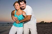 Couple at the beach at dusk Deerfield Beach, Florida, USA
