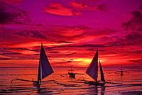 Philippines, Boracay Island, White Beach, outrigger boats at sunset