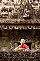 Myanmar (Burma) Mandalay Shwenandaw Kyaung (Golden Palace Monastery) with boy monk