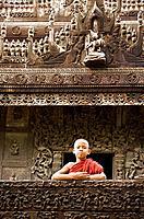 Myanmar (Burma) Mandalay Shwenandaw Kyaung (Golden Palace Monastery) with boy monk