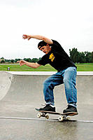 Skateboarder skating on the rim