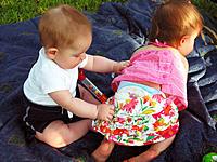 Toddler boy pulling pants off Toddler Girl