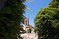 View of church through trees. Auvers sur Oise. Ile-de-France. France