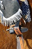 Close-up of a young cowboy´s boot in a stirrup, Shell, Wyoming. Usa