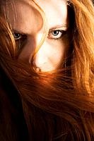 Red haired woman gazing at camera