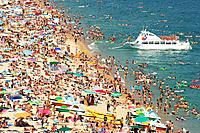People on the beach in summer, Lloret de Mar. Girona province, Catalonia, Spain