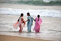Women bathing at Lighthouse beach, Kerala, India