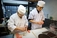 Japan, Kyoto, two master´s preparing pastry  Wagashi, types of colourful Japanese sweets