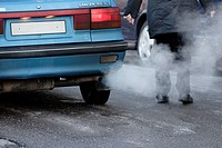 Exhaust fumes from a car beeing visible on a cold winter day in Sweden