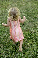 16 months old toddler running in the grass