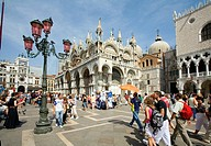 People sightseeing in St Marks Square in Venice , Italy