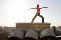 Woman doing yoga on roof