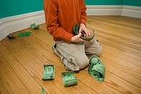 Boy counting paper money.