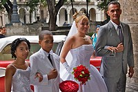 A bride and groom, with attendants just before the wedding ceremony.