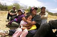 A 6-year-old girl cries in the arms of her aunt after their group was apprehended by the U. S. Border Patrol east of Sells on the Tohono O´odham Natio...