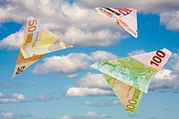 Euro banknotes flying
