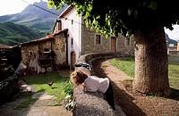 Girl watching some of gallinas.Posada Valdeón. Leon. Parque Nacional Picos de Europa.España