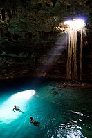 Mexico, Yucatan, Cenote Samula, near Valladolid, tourists enjoying a swim