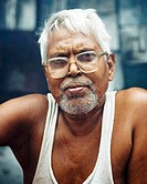 portrait of a grey haired man in india.
