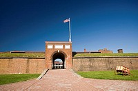 USA, MD, Baltimore. The arched entrance into the fortified walls of Fort McHenry is the only way in and out.