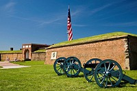 USA, MD, Baltimore. Cannons set outside the entrance to the historic Frot McHenry, where the Star Spangled Banner was written. Seen here with the hist...