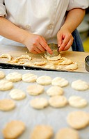Pastry chef making small pastries