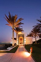 The seafood beach front restaurant of the luxury 5 star Chedi Hotel resort in Ghubrah, Muscat, Oman at sunset