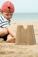 Boy and sandcastle