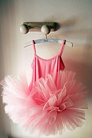 ballerina dress hanging from a perch