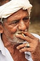 Indian man smoking a beedi cigarette  Kollam, Kerala, India