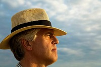 MEXICO Todos Santos Middle aged Caucasian male wearing straw hat look into distance, portrait, profile of face