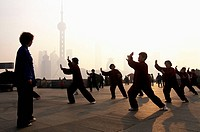 Early morning tai chi exercises on the Bund, Shanghai, China