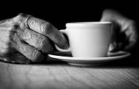 Time for coffee  Hands of elderly woman holding a cup